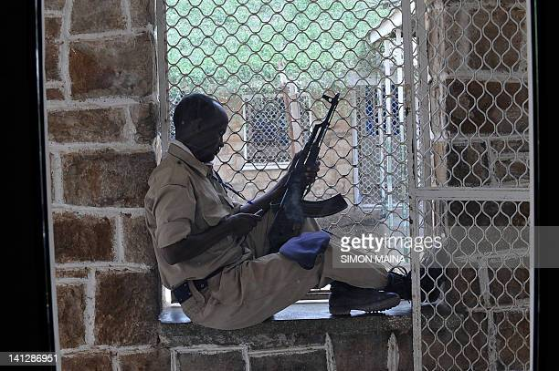 Somaliland prison warden sits on March 8 2012 in Hargesia's newlyrefurbished prison in the northern breakaway nation of wartorn Somalia Officers...