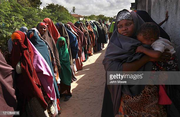 Somalis await treatment at an outpatient hospital run by the African Union Mission in Somalia , on August 17, 2011 in Mogadishu, Somalia. More than...