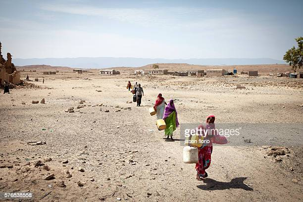 Somalis carrying water containers to a distribution point operated by Puntland Maritime Police Force The Puntland Maritime Police Force is a locally...