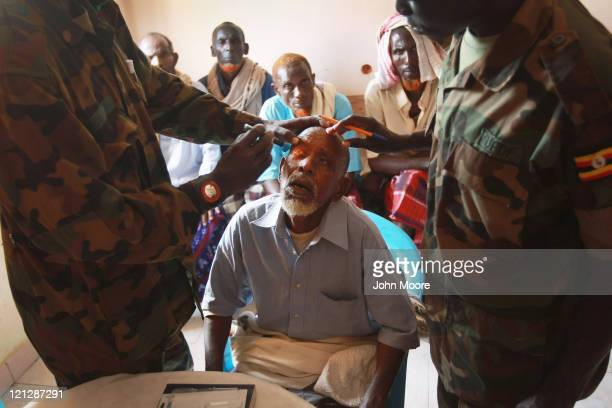 Somalis receive medical treatment at an outpatient hospital run by the African Union Mission in Somalia , on August 17, 2011 in Mogadishu, Somalia....