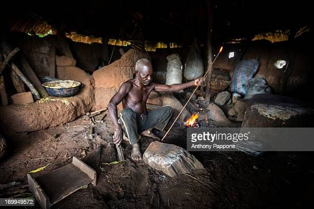 CONTENT] Somba blacksmith works with iron inside the hut tatasomba village near natitingou atakora region north benin