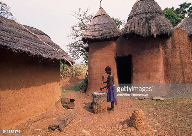 Somba Woman Working near Fortified House