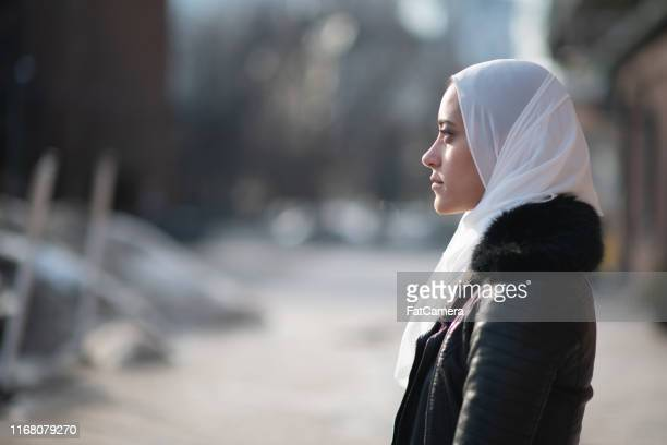somber muslim women - islam stock pictures, royalty-free photos & images