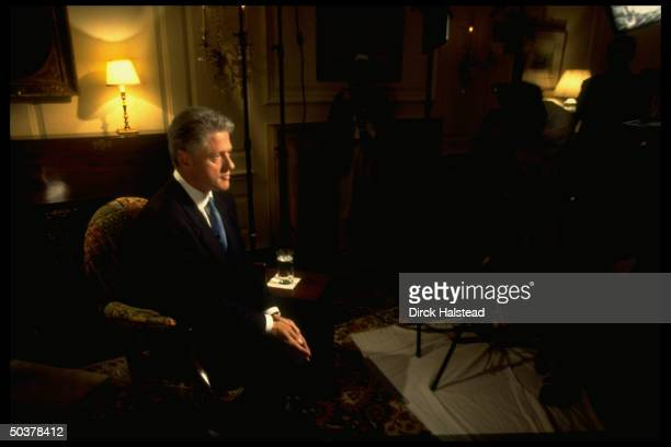 Somber Pres Bill Clinton sitting in White House Map Room before delivering his speech to nation about his alleged affair w former White House intern...