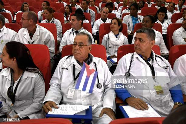 Some 100 Cuban doctors follow proceedings during their induction programme at the Kenya School of Government on June 11 2018 in Nairobi The doctors...