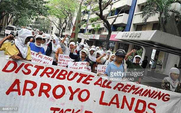 Some 100 landless Filipino farmers rally outside the offices of Jose Miguel Arroyo the husband of President Gloria Arroyo in Manila's financial...