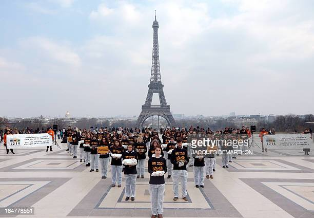 Some 100 meembers of the French animalprotection group L214 carry dead rabbits on March 27 2013 on the Trocadero plazza in Paris to protest against...