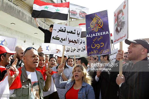 Some 100 Syrians protest outside the offices of the Qatari based AlJazeera satellite television station in the capital Damascus accusing it if of...