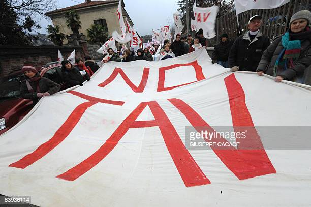 Some 10000 demostators with banners and flags printed with 'NO TAV' attend a protest against the highspeed train tunnel project in Susa on December 6...