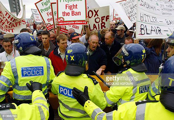 Some 10000 prohunt supporters face off with police during a protest of the Labour Party Conference in Brighton England 28 September 2004 The...