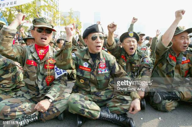 Some 10000 South Korean veterans of the Vietnam War shout antigovernment slogans during a rally in front of National Assembly on October 29 2004 in...