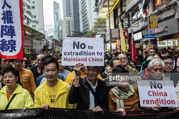 Some 12,000 demonstrators seen marching down Hong Kong's main thoroughfare protesting against the new proposed. Extradition laws were proposed by the...
