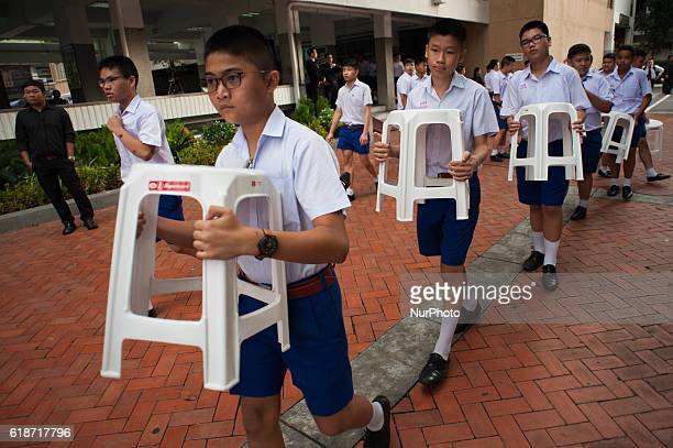 Some 1,250 students from the Assumption College flip their cards to form an image of Thailand's late King Bhumibol Adulyadej, in his honour, in...