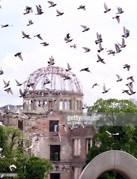 Some 1500 doves fly over the Abomb dome a symbol of the 1945 atomic bombing during a memorial service at the Hiroshima Peace Memorial Park 06 August...