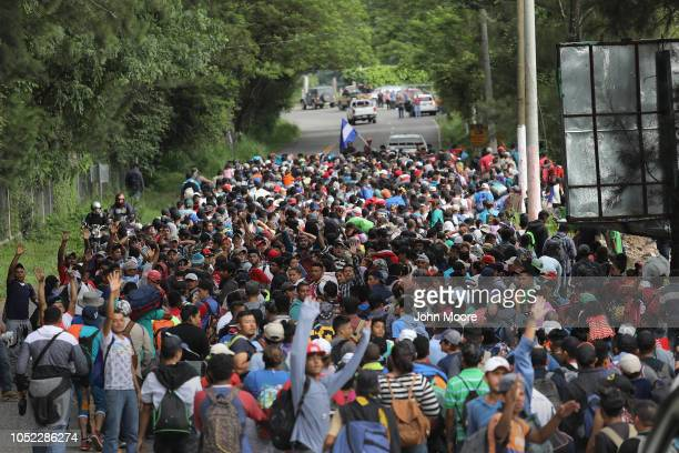 Some 1500 Honduran immigrants walk north in a migrant caravan on October 16 2018 near Esquipulas Guatemala The caravan the second of its size in 2018...