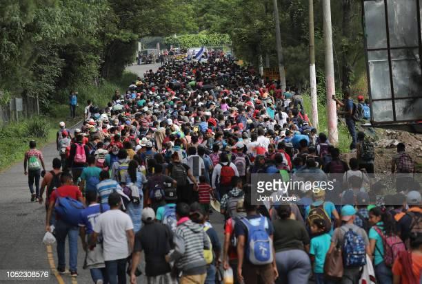 Some 1,500 Honduran immigrants walk north in a migrant caravan on October 16, 2018 near Esquipulas, Guatemala. The caravan, the second of its size in...