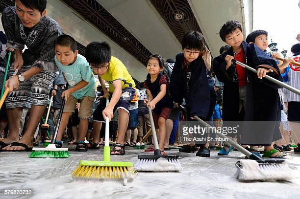 Some 1800 people take part in the 'Bridge Cleaning' at the Nihonbashi bridge on July 24 2016 in Tokyo Japan