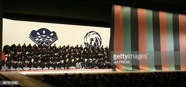 Some 200 Kabuki actors bow in the closing ceremony of the 60yearold landmark theatre as its final curtain is closing in Tokyo on April 30 2010...