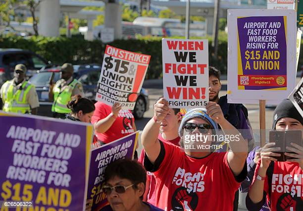 Some 200 low wage workers rally in a protest named Day of Disturbance to demand higher wages on November 29 2016 at San Diego International Airport...