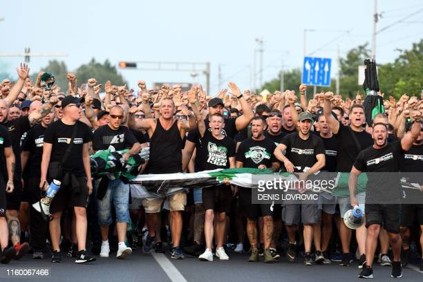 Some 2000 fans of Hungarian football club Ferencvaros cheer as they walk toward the Maksimir Stadium in Zagreb on August 6, 2019 to attend the UEFA...