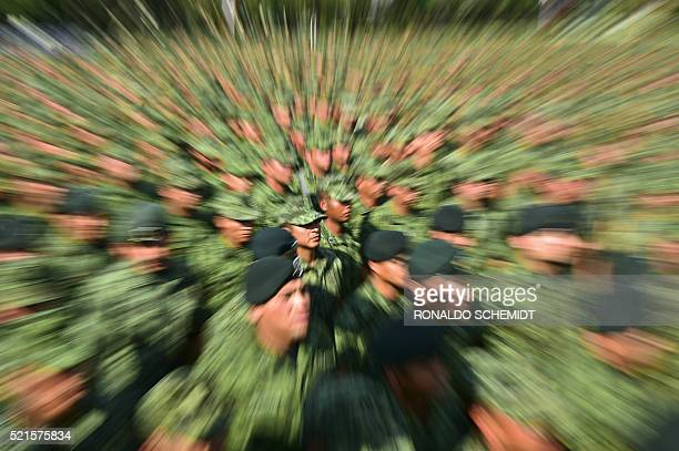 Some 26000 Mexican soldiers assemble at a military base in Mexico City on April 16 2016 to hear Mexican Defense Secretary Salvador Cienfuegos read...