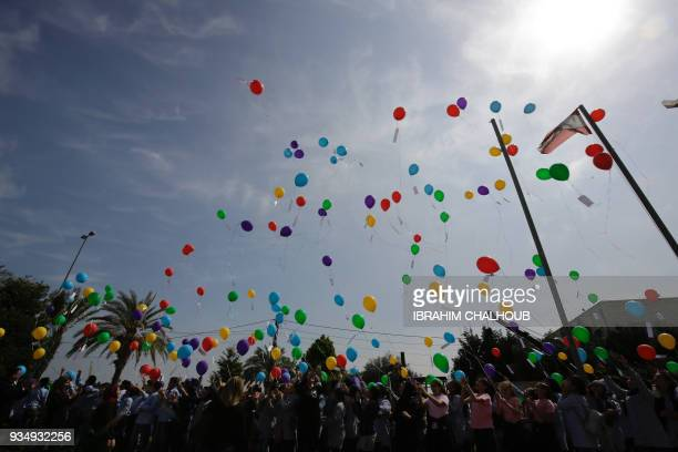 Some 300 Lebanese public school students take part in a release of balloons carrying personalized messages written in French to celebrate the...