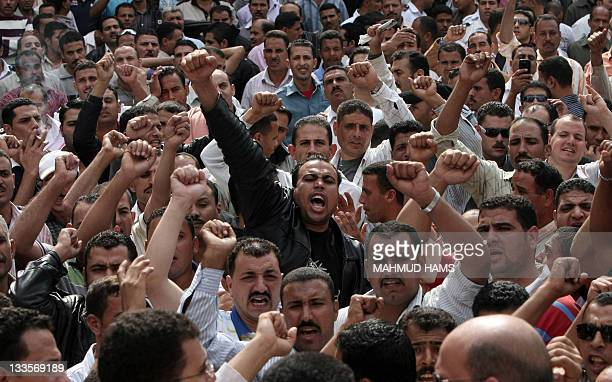 Some 3000 policemen protest for a second day outside the interior ministry headquarters in Cairo on October 25 to demand the 'cleansing' of their...