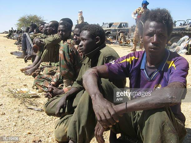 Some 40 prisoners of the Union of Forces for Democracy and Development sit guarded by Chadian soldiers 27 November 20007 90 kilometres to the east of...