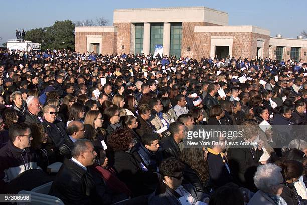Some 4,000 mourners gather on the boardwalk near the sea at Jacob Riis Park in the Rockaways, Queens, to remember those from their communities who...