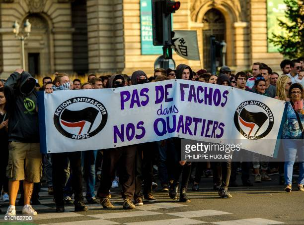 """Some 500 people, mainly from far-left groups, protest on September 24, 2016 in Lille against the opening of a private bar named """"La Citadelle"""" by..."""