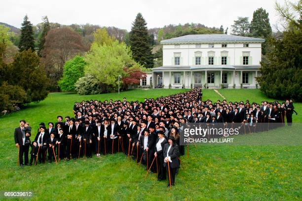 Some 662 People dressed as 'The Tramp' pose for a group picture to mark the first anniversary of Chaplins World By Grevin, and Charlie Chaplins...