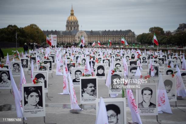 TOPSHOT Some 800 portraits of victims have been displayed by representatives in France of the People's Mujahedin of Iran on the Esplanade des...