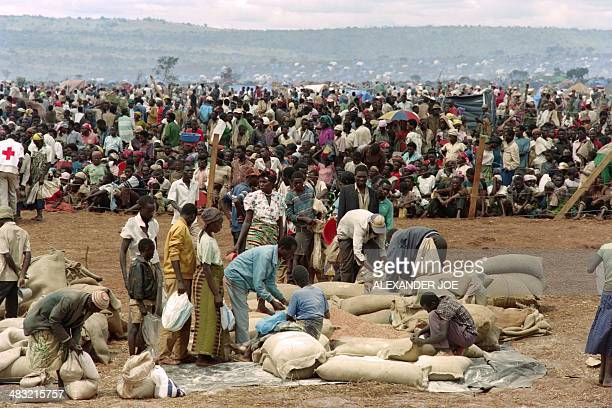 Some 90000 Rwandan refugees wait to get food from the Red Cross on May 20 1994 in the Benako Tanzania refugee camp Hundreds of thousands of Rwandans...