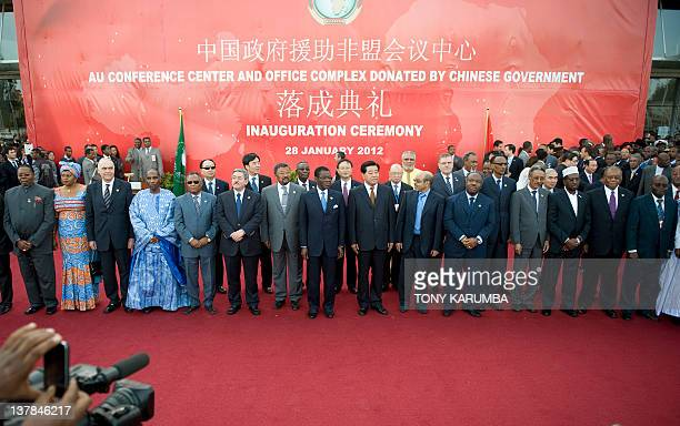 Some Africa Heads of State and other dignitaries pose for a photo during the inauguration of a highrise African Union headquarters built and donated...
