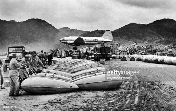 Some Allied Soldiers Unloading Some Napalm Bombs Somewhere In South Corea On The Background A Curtiss C 46 Aircraft Landing On January 20 1951