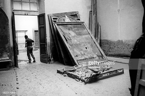 Some altar pieces damaged by the flood and leant against a wall Florence 1966