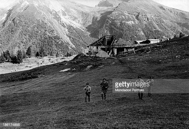 Some armed young men guarding the area around the Guardia di Finanza barracks blown up by some separatist terrorists of the Upper Adige Malga Sasso...