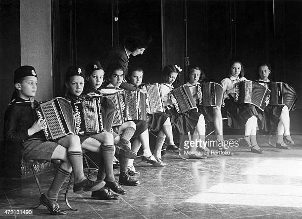 'Some Balilla and Piccole Italiane attending an accordion course Italy 1930s '