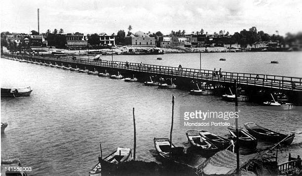 Some boats docked on the River Tigris near bridge Maude Baghdad 1900s