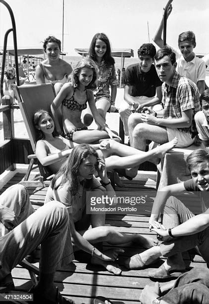 Some boys and girls smiling on a dock Forte dei Marmi August 1966