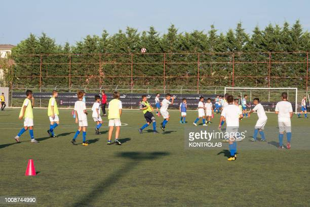 Some boys play football during the inauguration of the Milan Academy technical center in Corigliano Calabro in Calabria southern Italy a native city...