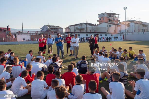 Some boys with Ac Milan staff during the inauguration of the Milan Academy technical center in Corigliano Calabro in Calabria southern Italy a native...