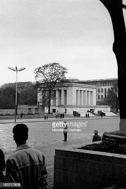 Some Bulgarian citizens crossing Battenberg Square near the Georgi Dimitrov mausoleum The building was demolished in 1999 Sofia November 1961