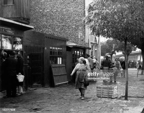 Some Bulgarian citizens looking at the stalls in the George Kirkov market Sofia November 1961