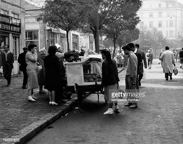 Some Bulgarian women buying baked pumpkin from a street seller Sofia November 1961
