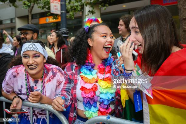 Some bystanders become excited after seeing one of the stars of the Netflix series '13 Reasons Why' at the annual LGBTQI Pride Parade on June 25 2017...