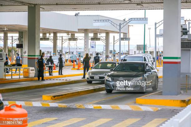 some cars enter mexico by crossing the calexico border in the southern united states - crossing sign stock pictures, royalty-free photos & images