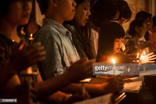 Some Catholics lit candles during the ceremony of Easter Light in Holy Saturday in Parish Church Saint Petrus Pekalongan Central Java Indonesia on...
