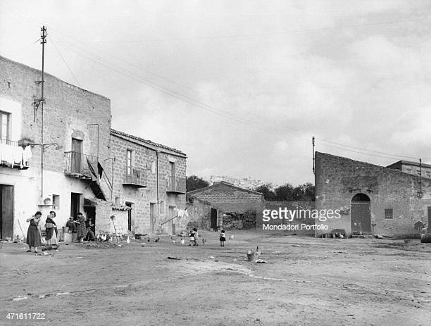 'Some children playing in the farmyard Agrigento December 1956 '