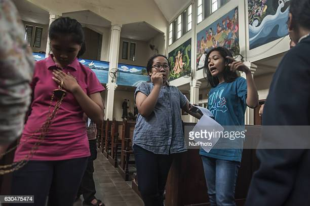 Some children preparing for Christmas in Church Saint Antonius Yogyakarta Indonesia on December 23 2016 This activities preparation Christmas in...